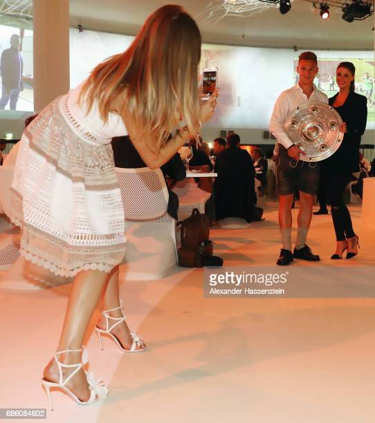 Cathy Hummels takes a photo of Joshua Kimmich and his partner Lina Meyer during the FC Bayern Muenchen Championship party following the Bundesliga...