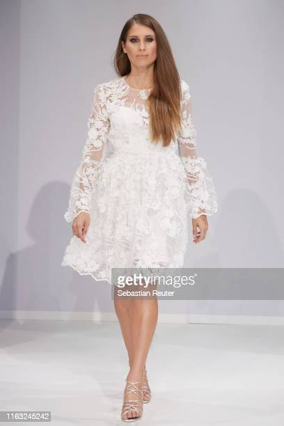 Cathy Hummels walks the runway at the Unique Fashion Show Spring-Summer 2020 at Oceandiva on July 20, 2019 in Dusseldorf, Germany.