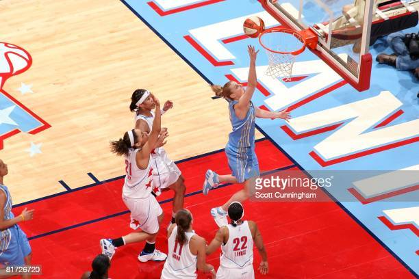 Cathy Joens of the Chicago Sky puts up a shot against Tamera Young Jennifer Lacy Kristen Mann and Betty Lennox of the Atlanta Dream during the WNBA...