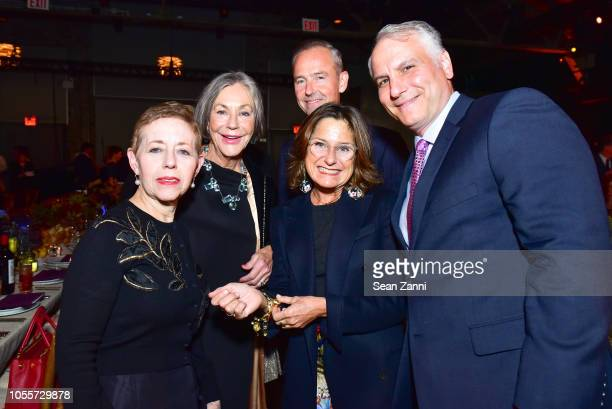 Cathy Kaplan Alice Walton Julian She Liz Swig and Michael Hoeh attend the 2018 Aperture Gala at Cedar Lake on October 30 2018 in New York City