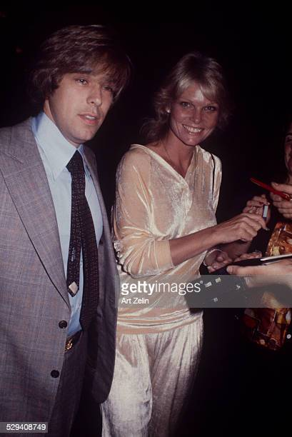Cathy Lee Crosby in a velour pants suit signing autographs circa 1970 New York
