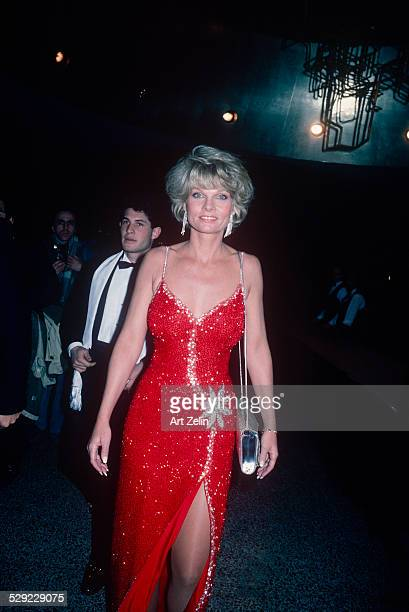 Cathy Lee Crosby wearing a red beaded gown circa 1970 New York