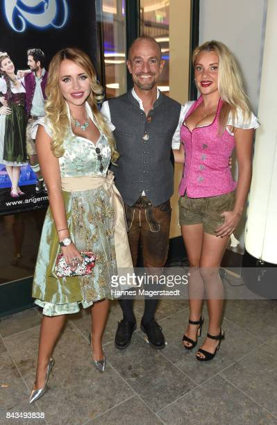 Cathy Lugner Peyman Amin and Evelyn Burdecki during the Angermeier Trachten Nacht at Alte Kongresshalle on September 6 2017 in Munich Germany