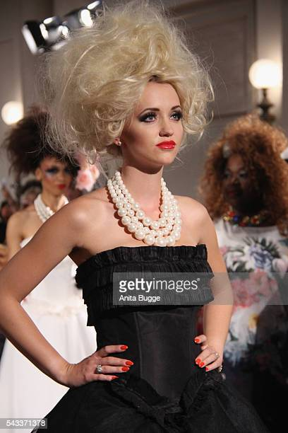 Cathy Lugner walks the runway during the fashion staging of the fairy tale 'Die zertanzten Schuhe' by Harald Gloeoeckler at Hotel de Rome on June 27...