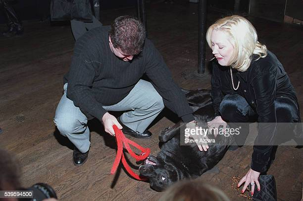 Cathy Moriarty playing with a dog