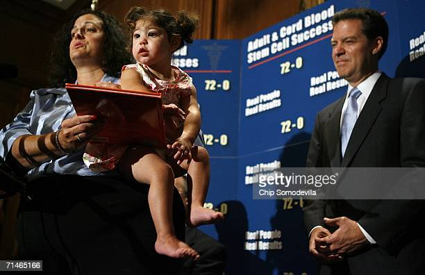 Cathy Pell and her daughter, 22-month-old Abby, join Sen. Sam Brownback for a news conference in the run up to a series of U.S. Senate votes on stem...