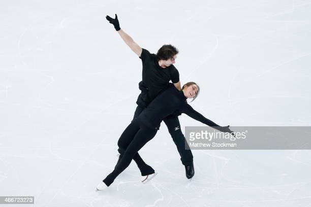 Cathy Reed and Chris Reed of Japan practice during Figure Skating Pairs training ahead of the Sochi 2014 Winter Olympics at Iceberg Skating Palace on...