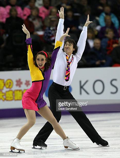 Cathy Reed and Chris Reed of Japan skate in the Ice Dance Free Dance Program during the 2013 ISU World Figure Skating Championships at Budweiser...