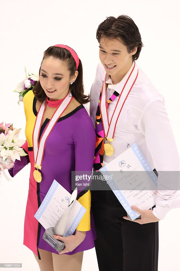 Cathy Reed (L) and Chris Reed pose for photographs after the medal ceremony during day three of the 81st Japan Figure Skating Championships at Makomanai Sekisui Heim Ice Arena on December 23, 2012 in Sapporo, Japan.