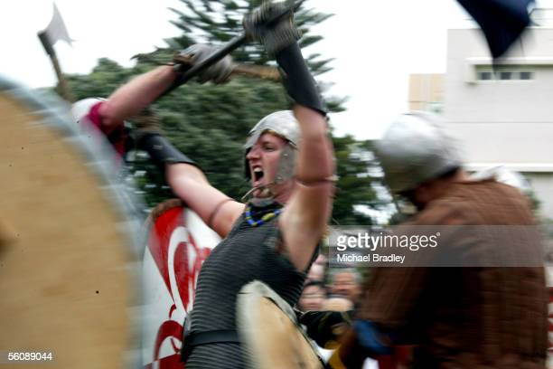 Cathy Renner from the Cyrmy group and Auckland Norsemen competes in a mock battle between the Scots and Vikings at the Auckland Highland Games held...