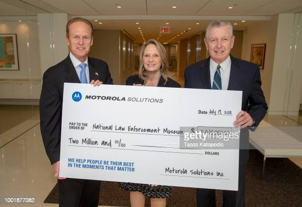 Cathy Seidel, Vice President of Government Affairs, Motorola Solutions , presents $2 million in funding to the National Law Enforcement Museum,...
