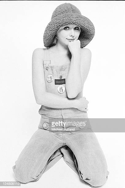 Cathy Symmonds fashion model wearing 1970s fashions including dungarees with a Marc Bolan badge studio London 1973