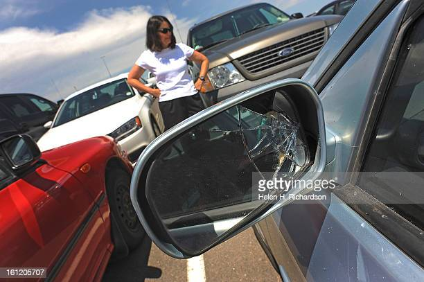 Cathy Tate of Boulder arrived at her car in the West Economy lot at Denver International Airport to find hail damage on her car and a broken side...