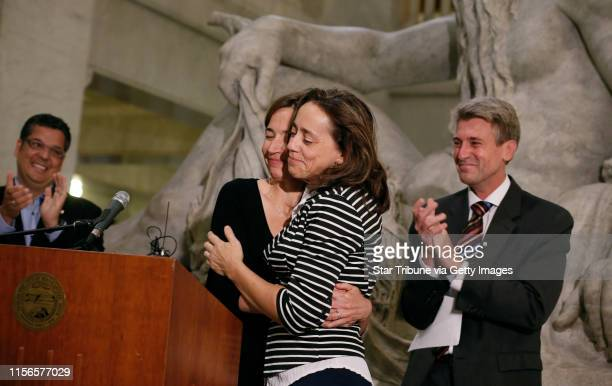 Cathy ten Broeke left and her partner Margaret Miles hugged each other after Minneapolis Mayor RT Rybak introduced them along with Jeff Isaacson and...