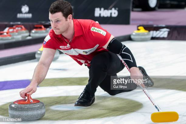 Catlin Schneider of Canada Team 2 pushes the stone during the Men's Curling round robin match between China and Canada on the Day 4 of the 20182019...