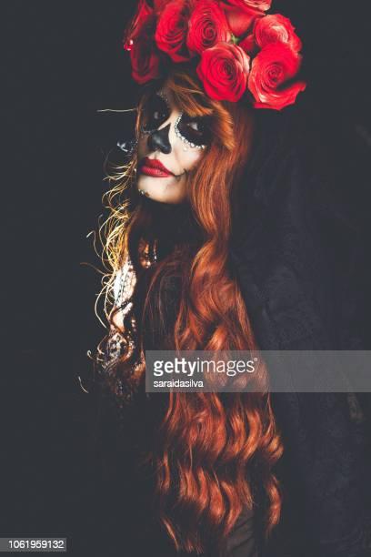 catrina roses and makeup - dia de muertos - la catrina stock photos and pictures