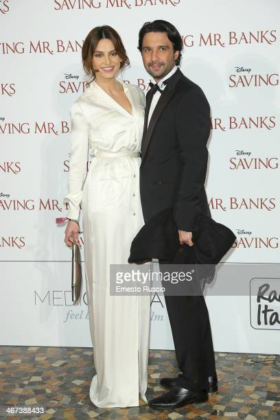 Catrinel Marlon and guest attend the 'Saving Mr Banks' premiere at The Space Moderno on February 6 2014 in Rome Italy