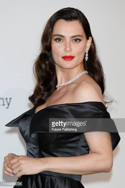 Catrinel Marlon at the amfAR Cannes Gala 2019 at Hotel du CapEdenRoc on May 23 2019 in Cap d'Antibes France
