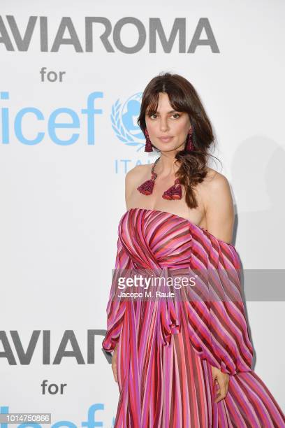 Catrinel Marlon attends a photocall for the Unicef Summer Gala Presented by Luisaviaroma at Villa Violina on August 10 2018 in Porto Cervo Italy