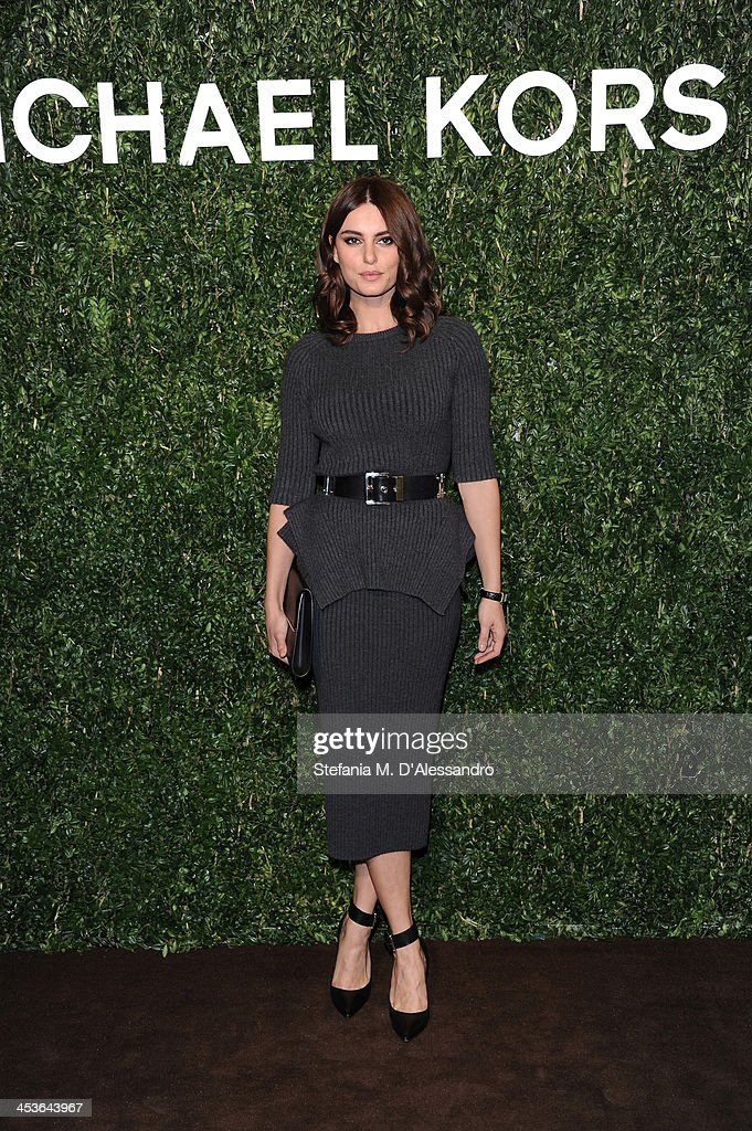Catrinel Marlon attends Michael Kors To Celebrate Milano on December 4, 2013 in Milan, Italy.