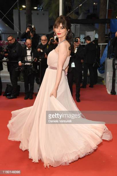 Catrinel Marlon departs the screening of The Whistlers during the 72nd annual Cannes Film Festival on May 18 2019 in Cannes France