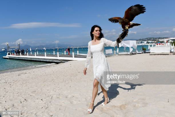 Catrinel Marlon is seen wearing Alberta Ferretti dress bag and shoes Christian Louboutin during the 71st annual Cannes Film Festival at on May 11...