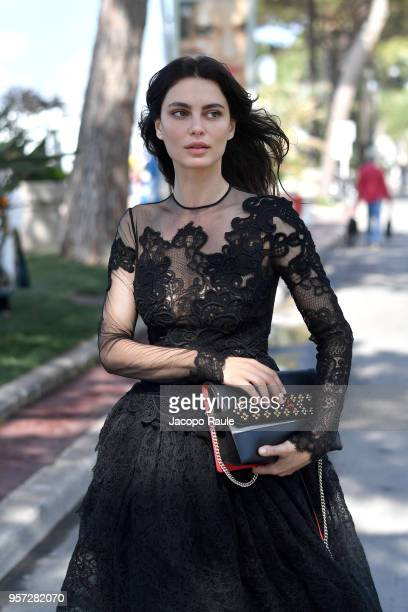 Catrinel Marlon is seen wearing dress Ermanno Scervino bag and shoes Christian Louboutin during the 71st annual Cannes Film Festival at on May 11...