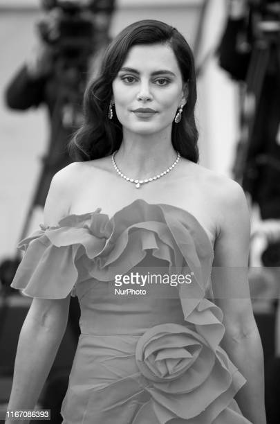 Image was converted to black and white Catrinel Marlon walks the red carpet ahead of the closing ceremony of the 76th Venice Film Festival at Sala...