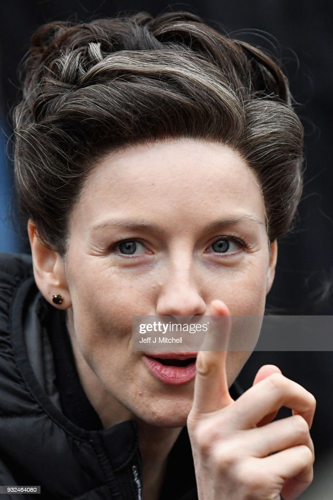 Catriona Balfe from the TV series Outlander departs a filming location at St Andrew's Square on March 15, 2018 in Glasgow, Scotland. Dozens of fans have gathered to catch a glimpse of Sam Heughan and co-star Caitriona Balfe as they filmed in the city's Salmarket area for series four of the programme.