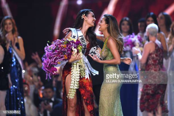 Catriona Gray of the Philippines is congratulated by by Miss Universe 2017 DemiLeigh NelPeters while being crowned as the new Miss Universe 2018 on...