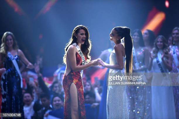 Catriona Gray of the Philippines reacts after winning the Miss Universe 2018 with Miss Universe first runner up Tamaryn Green of South Africa on...