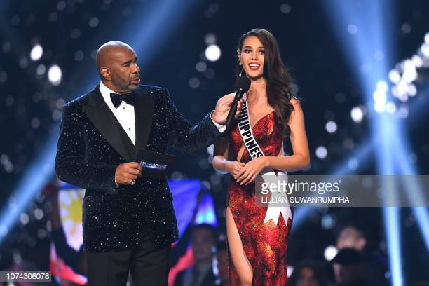 TOPSHOT Catriona Gray of the Philippines speaks while host Steve Harvey listens during the interview of top three finalists of the 2018 Miss Universe...