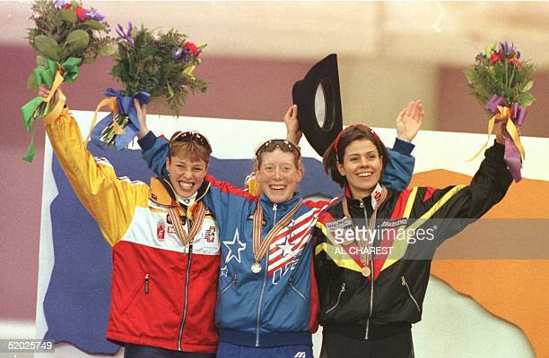 Catriona LeMayDoan of Canada silver Christine Witty of USA gold and Franziska Schenk of Germany bronze stand on the podium after the1000 meter event...