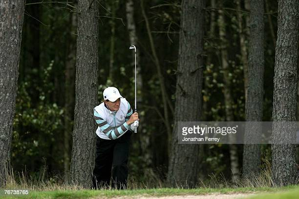 Catriona Matthew hits out of the trees on the 11th during the morning foursomes at the Solheim Cup at Halmstad Golf Club on September 14, 2007 in...