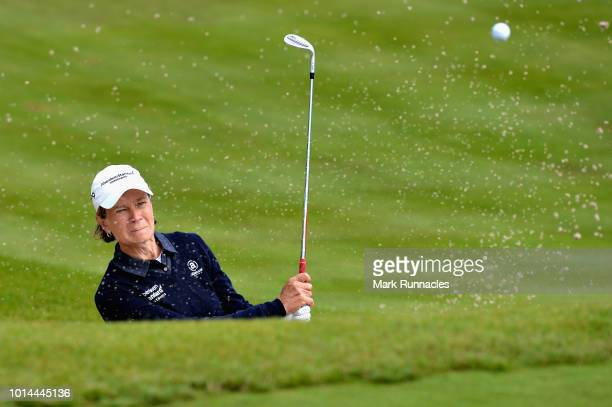 Catriona Matthew of Great Britain plays from a bunker on hole eighteen during match 5 of Group D during day three of the European Golf Team...
