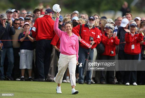 Catriona Matthew of Scotland acknowledges the crowd on the 18th green on her way to victory during the final round of the 2009 Ricoh Women's British...