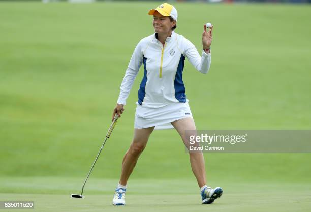 Catriona Matthew of Scotland and the European Team acknowledges the crowds after holing a putt on the first green in her match with Karine Icher...