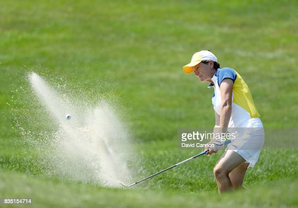 Catriona Matthew of Scotland and the European Team plays her second shot from a difficult position in a bunker on the 17th hole in her match with...