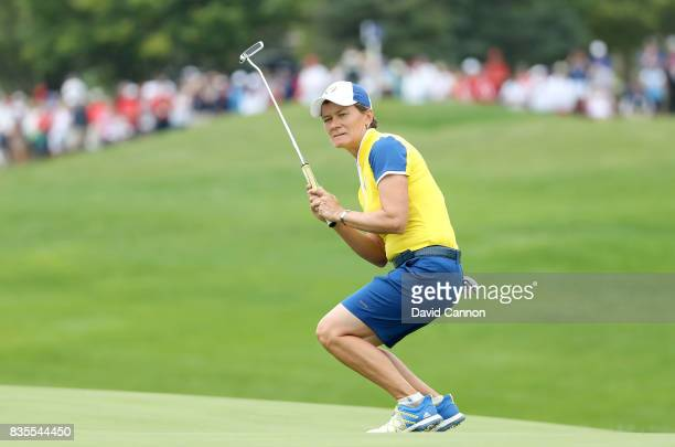 Catriona Matthew of Scotland and the European Team reacts as her putt on the 17th hole just misses in her match with Karine Icher of France against...