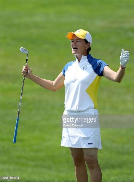 Catriona Matthew of Scotland and the European Team reacts to almost holing her second shot from a difficult position in a bunker on the 17th hole in...