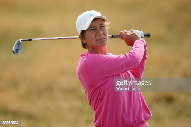 Catriona Matthew of Scotland hits her approach shot to the 16th green on her way to victory during the final round of the 2009 Ricoh Women's British...