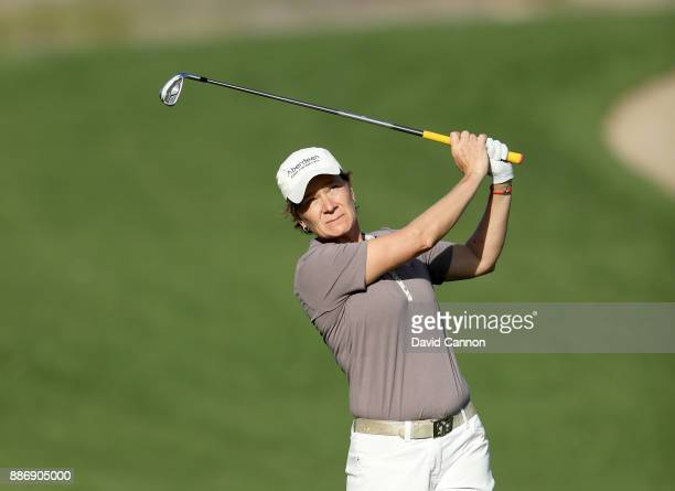 Catriona Matthew of Scotland plays her second shot on the par 4 14th hole during the first round of the 2017 Dubai Ladies Classic on the Majlis...