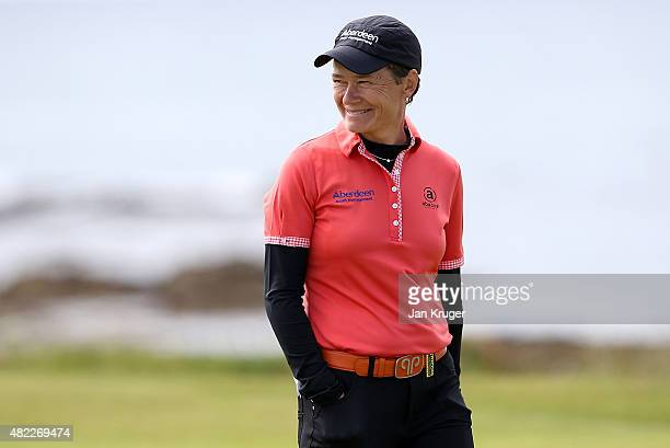 Catriona Matthew of Scotland smiles during a practise round ahead of the Ricoh Women's British Open on the Ailsa Course at Trump Turnberry Resort on...