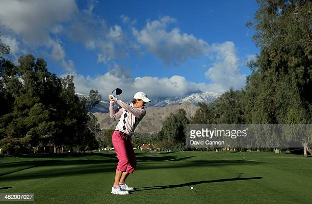 Catriona Matthew of Scotland tees off at the par 4 third hole during the proam as a preview for the 2014 Kraft Nabisco Championship on the Dinah...