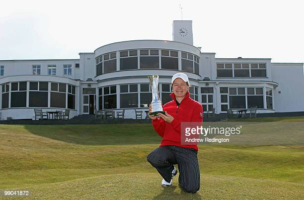 Catriona Matthew of Scotland the defending champion poses with the trophy during the 2010 Ricoh Women's British Open Media Day at Royal Birkdale on...