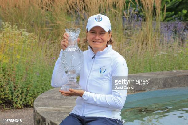 Catriona Matthew of Scotland the European Team captain holds the Solheim Cup beside the Gleneagles Hotel during the European Solheim Cup Team...