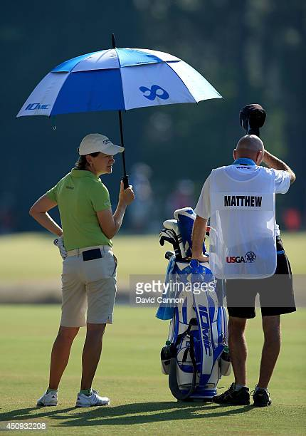 Catriona Matthew of Scotland waits to play her second shot at the par 4 12th hole with her caddie Verners Tess during the second round of the 69th US...
