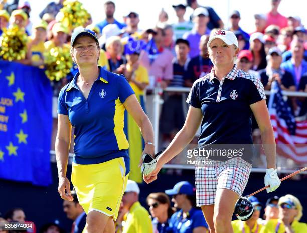 Catriona Matthew of Team Europe and Stacy Lewis of the United States tap one another as they leave the first tee during the final day singles matches...