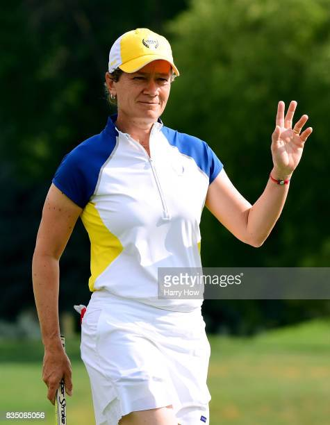 Catriona Matthew of Team Europe celebrates her putt on the fourth green during the morning foursomes matches of the Solheim Cup at the Des Moines...