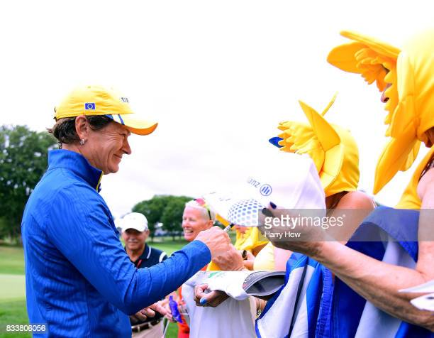 Catriona Matthew of Team Europe signs autographs for fans during practice for the Solheim Cup at the Des Moines Golf and Country Club on August 17...